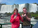 Tourists having their picture taken at Iguazu Falls, Argentina