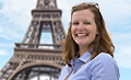Girl posing in front of the Eiffel Tower