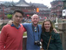 Tourists posing in front of Chinese buildings