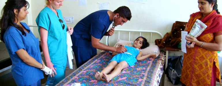 GoEco medical team checking a sick little girl