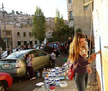 Marisa Participating in a Community Mural Painting Project in Salt, Jordan