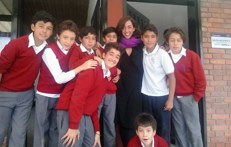 International teacher with male Colombian students