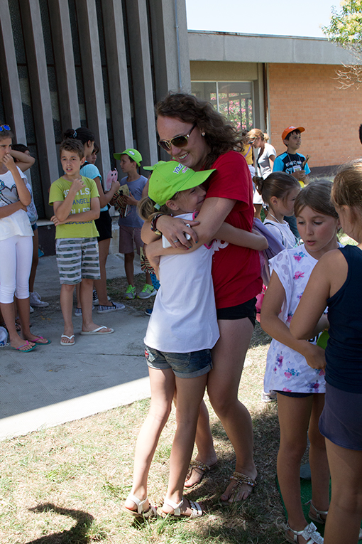 Camper hugging her camp counselor