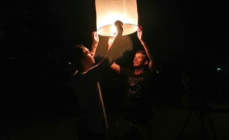 Friends doing a lantern release