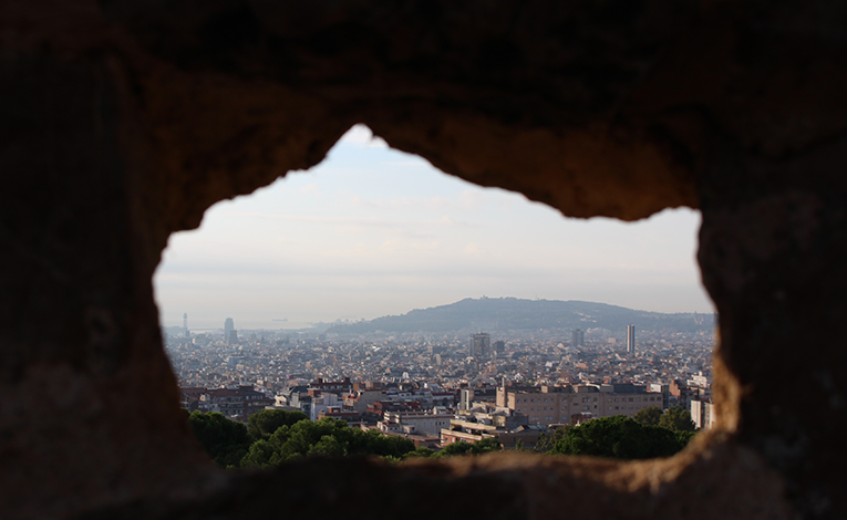 A view of Barcelona through a hole in rock