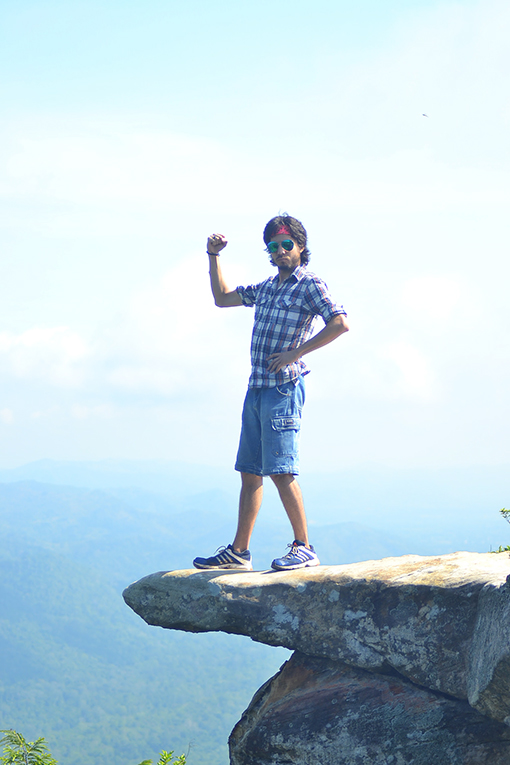 Man standing on a peak at Pa Hin Ngam National Park in Thailand