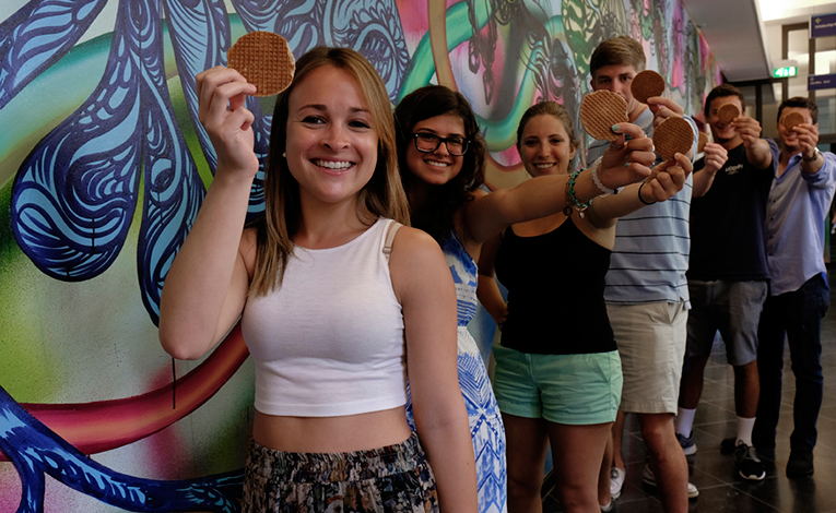 Students holding stroopwafels