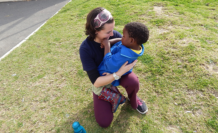 Volunteer in South Africa hugging a local boy