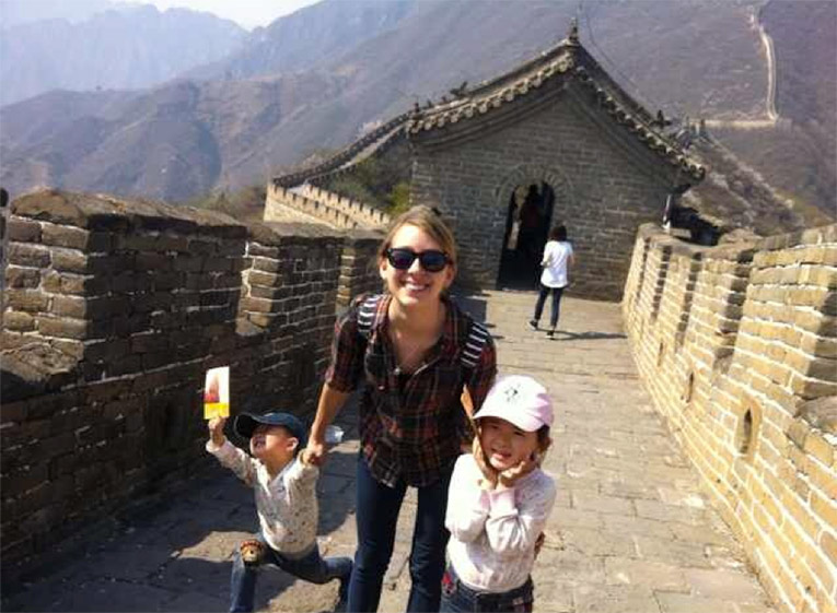 An au-pair with the kids on the Great Wall of China.