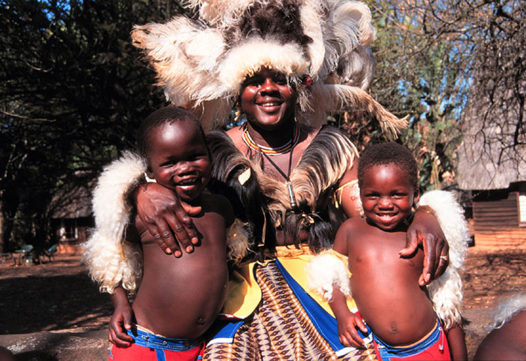 Swazi father with his sons in traditional dress