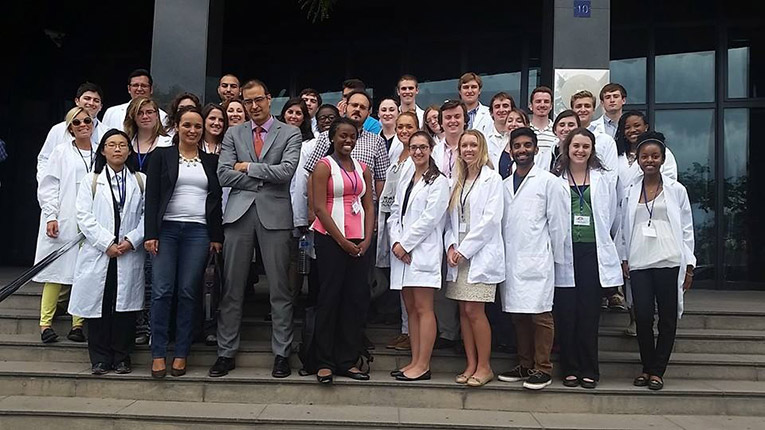 Medical interns with local officials and doctors in Spain