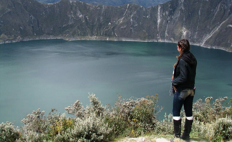 Girl looking at Laguna Quilotoa in the Andes