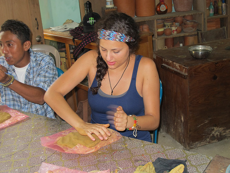 ISIS Belize participant making Mayan Pottery in Belize