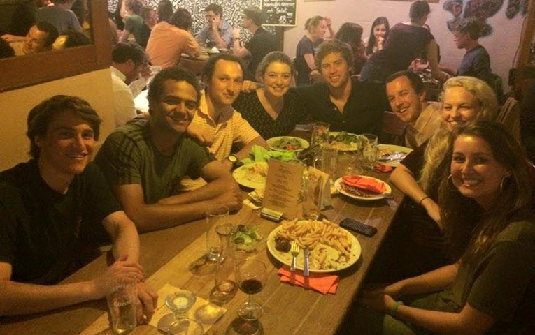 International students eating dinner at a restaurant in Freiburg, Germany