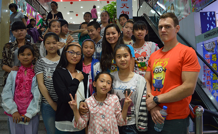 Volunteers with local students on a field trip to the grocery store in China