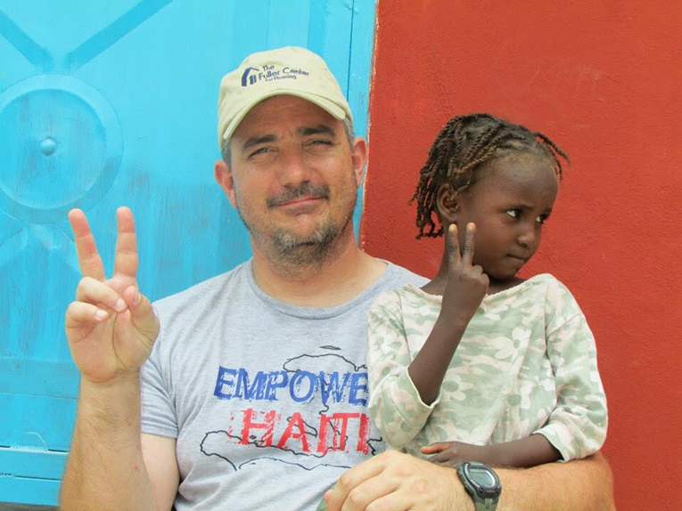 Volunteer in Haiti with local girl