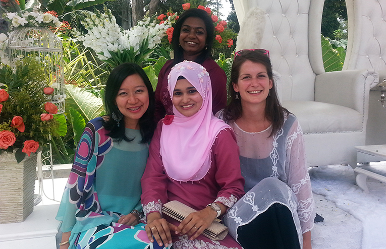 Friends at a wedding in Malaysia