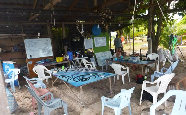 Outdoor living and dining area of campsite in Malaysia