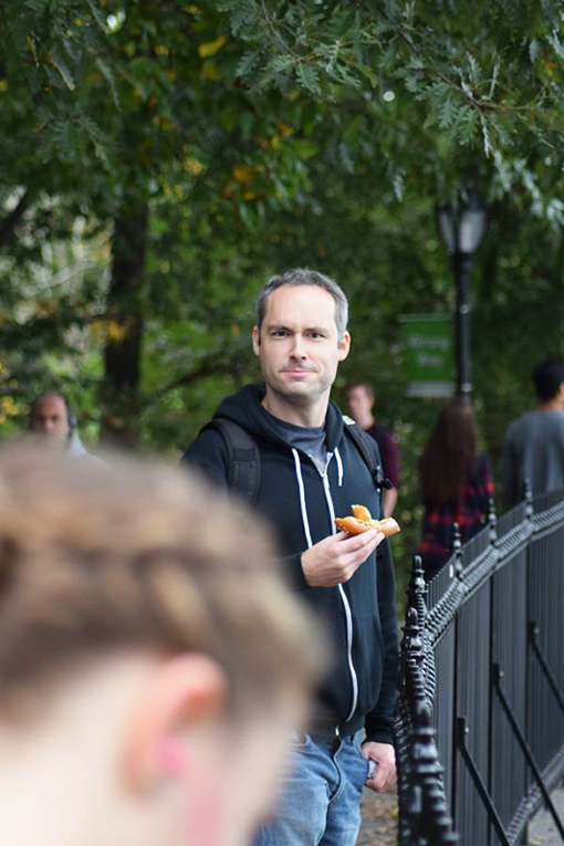 Man eating a pretzel in Central Park, New York City