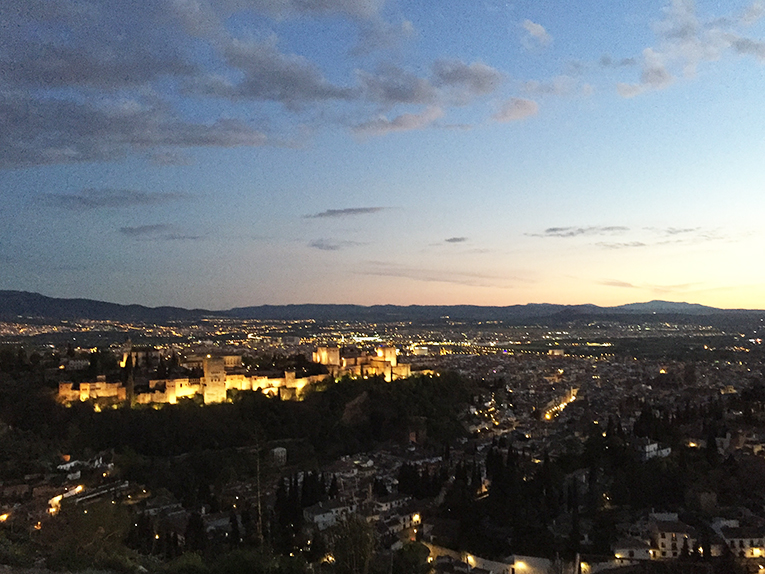 View of the Alhambra at night from Mirador San Miguel Alto in Granada, Spain