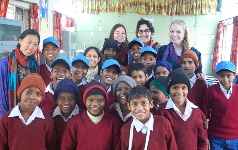 Volunteer teachers with local students in India