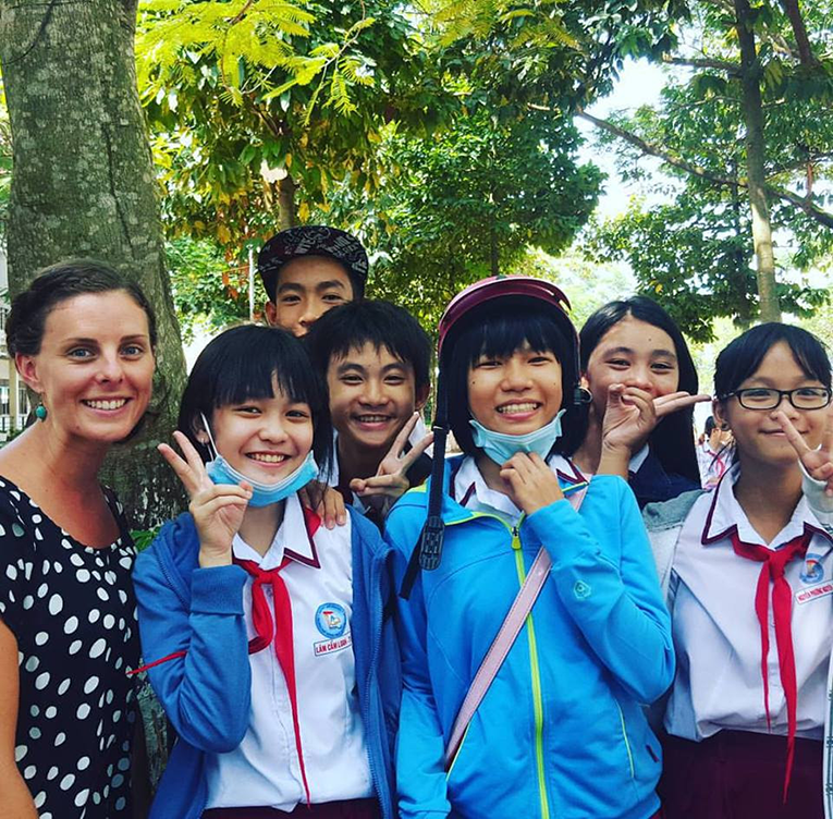 International teacher with primary students in An Giang, Vietnam
