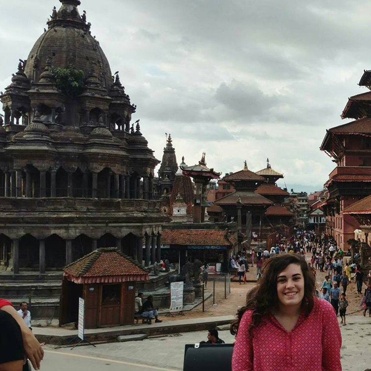 Girl in front of Bhaktapur Durbar Square in Nepal