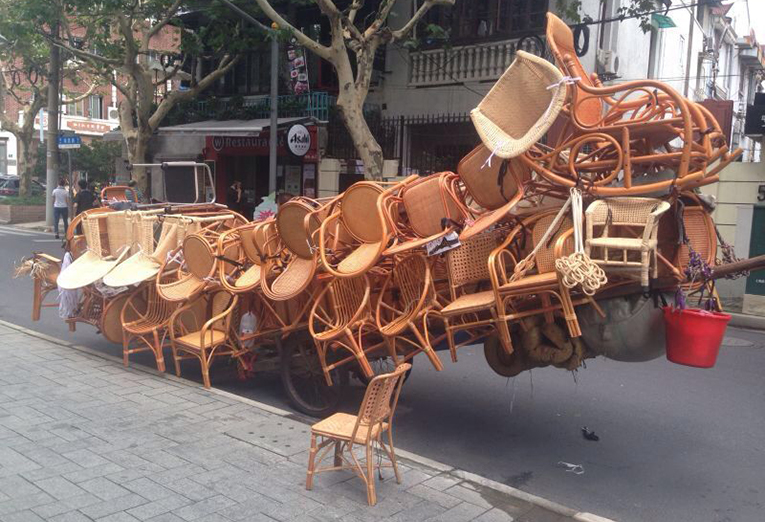 Wicker chairs on a street in China
