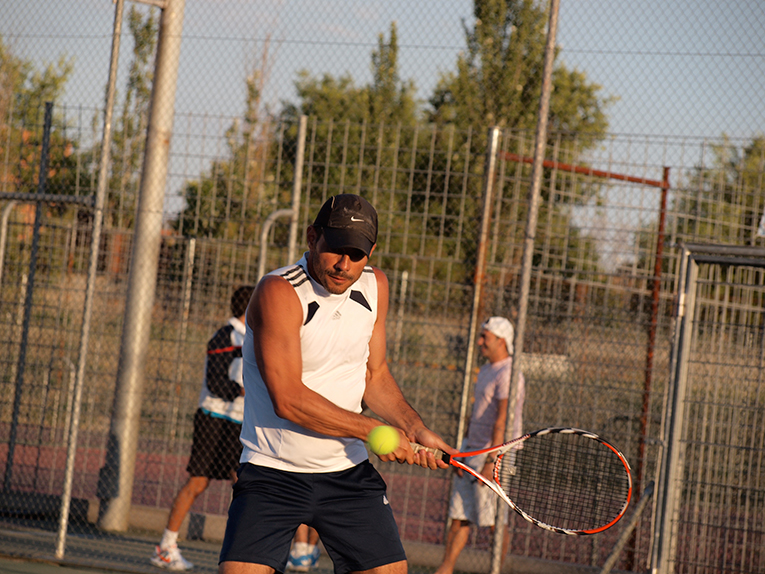 Man playing tennis at a tournament in Madrid, Spain