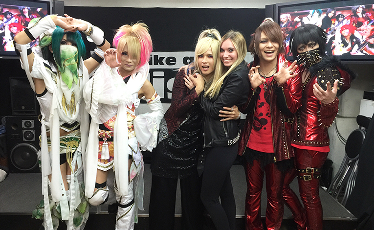 Foreigners with cosplayers in Tokyo
