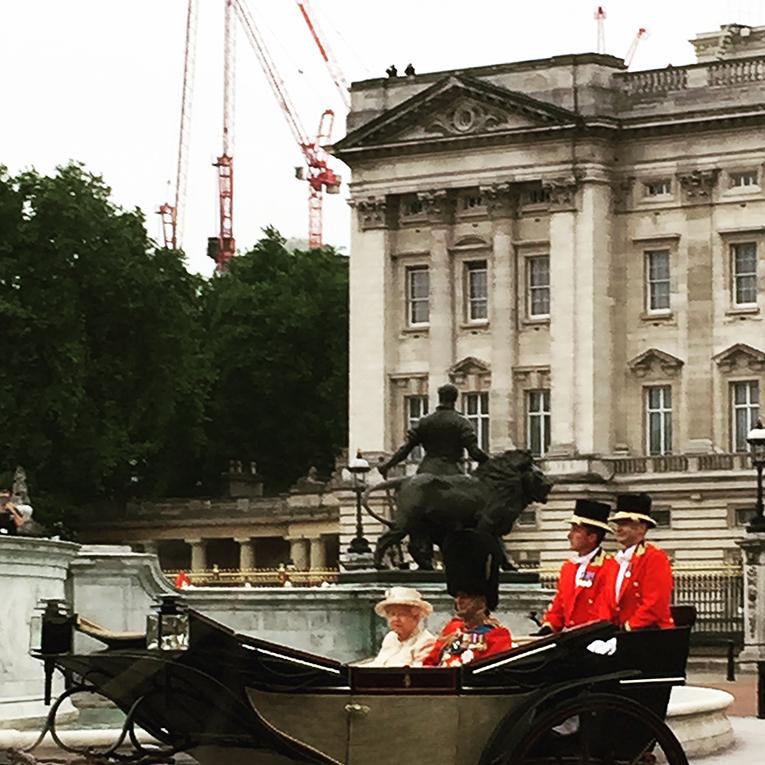 Queen Elizabeth II riding in her carriage in London, England