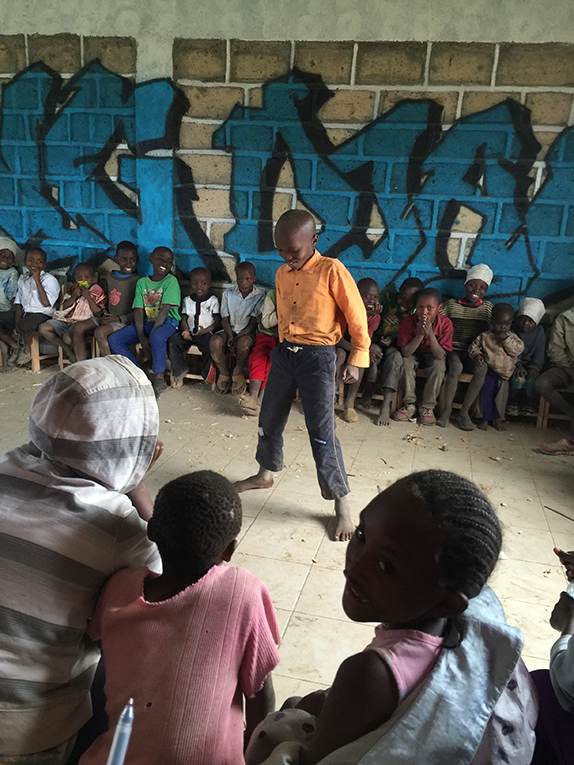 Kenyan child showing off his talent