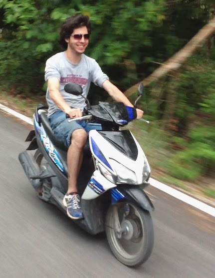 Riding a motorbike in the jungle of Natab in Thailand