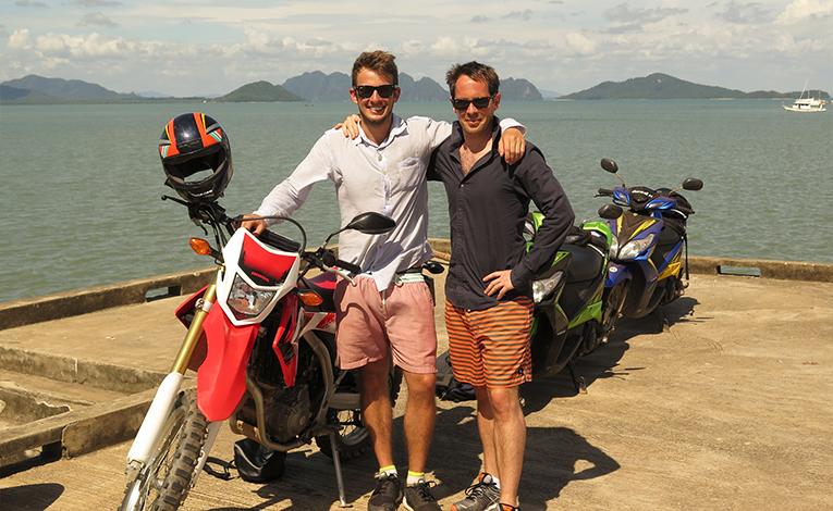 Men on a motorcycle tour of Koh Lanta, Thailand