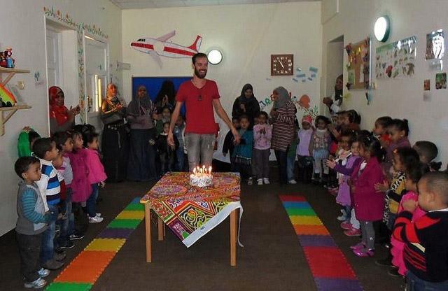 Local students celebrating their international teachers birthday in Egypt