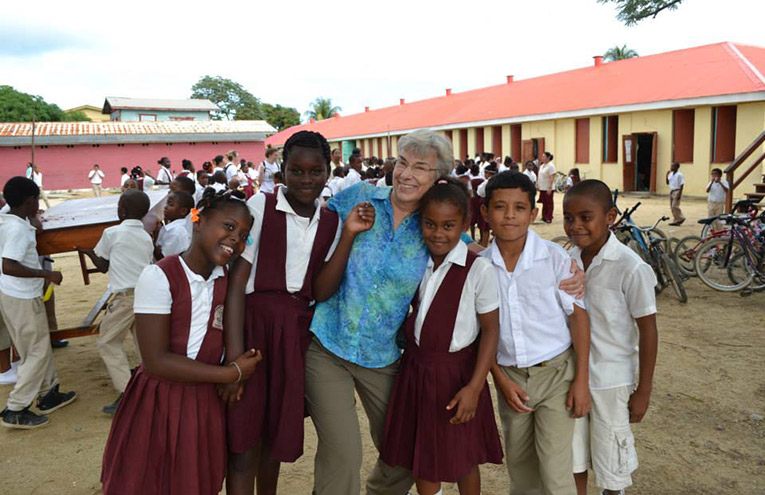 Volunteer teacher in Dangriga, Belize with local students
