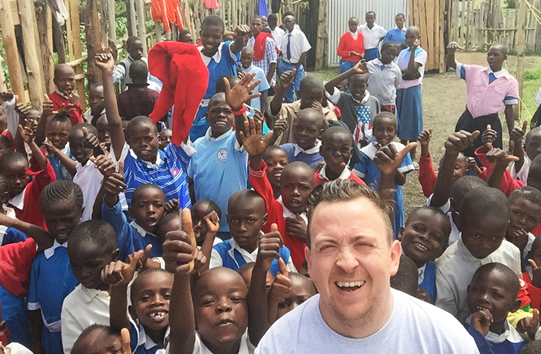 Selfie of a volunteer and local children in Kenya