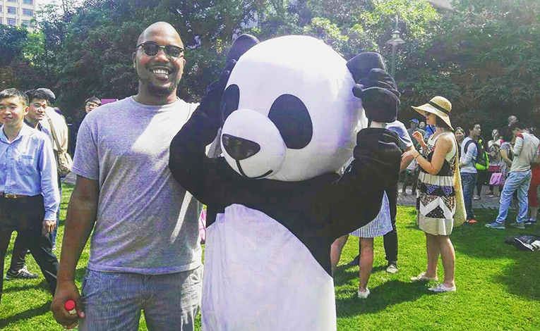 Man with someone dressed in a Panda costume in Shanghai, China