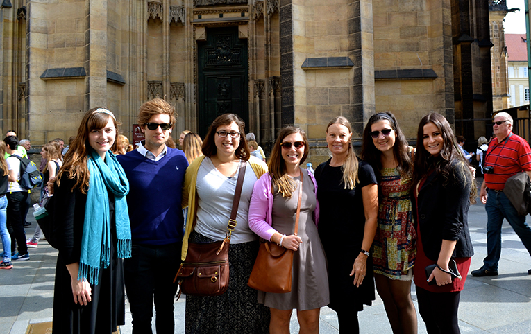 Friends in front of the gothic doors of St. Vitus Cathedral in Prague