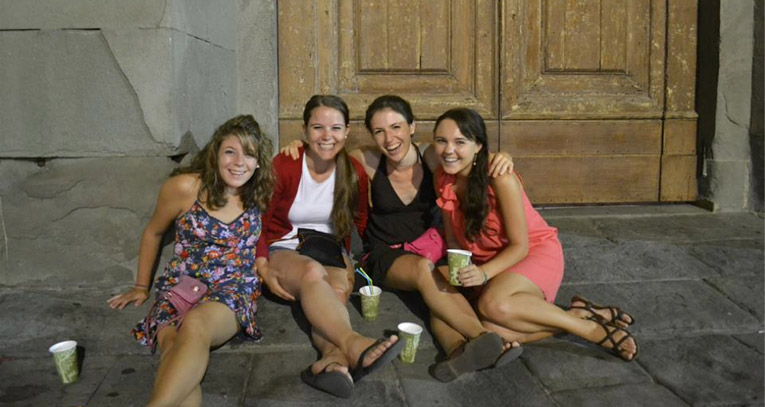Study abroad students drinking wine in Piazza di Spiritu in Italy