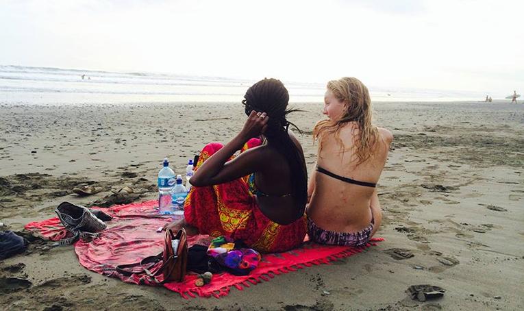 Girls sitting on a beach in Costa Rica