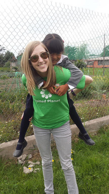 Volunteer playing with a child in Ecuador
