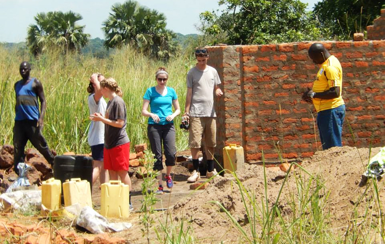 Construction volunteers at a project site in Uganda