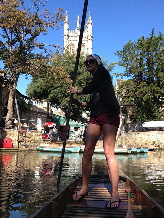 Punting under the Magdalen Bridge in Oxford, England
