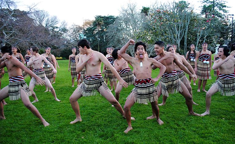Maori men and women doing The Haka dance in New Zealand