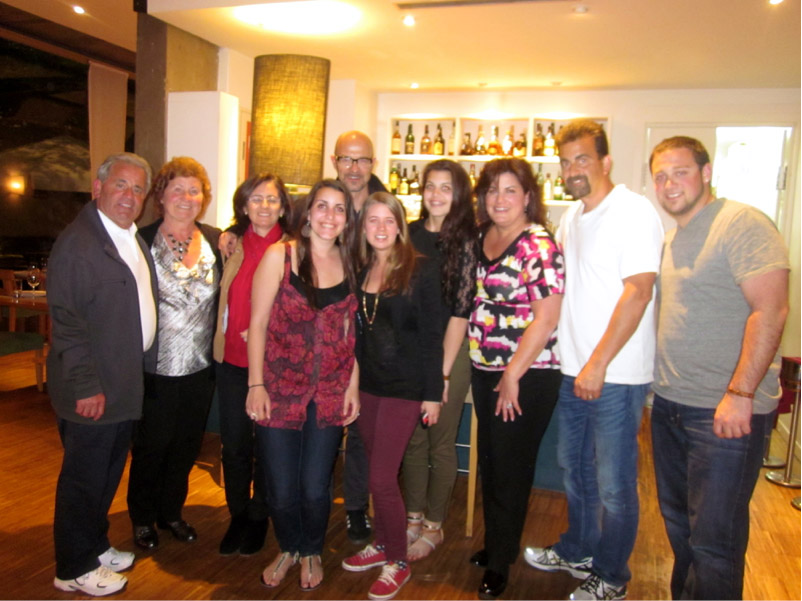 Study abroad student with her family and host family in Madrid, Spain.