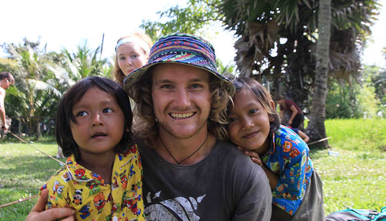 International volunteer with children in Cambodia