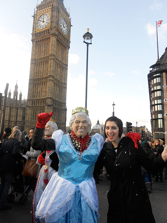Girl with a man dressed as the Queen near Big Ben in London