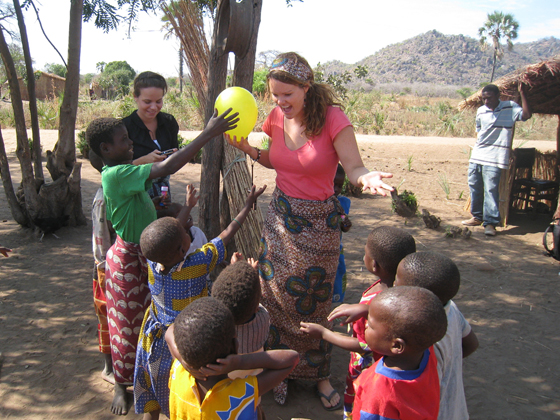 Volunteers playing with the local children in Malawi