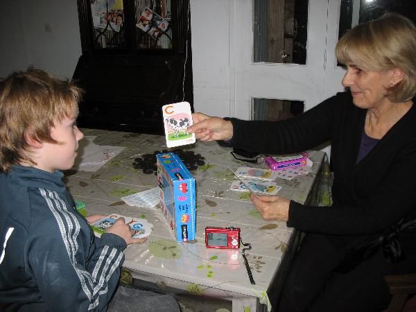 A mother showing a alphabet flash card
